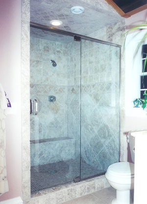 Frameless shower enclosure using header and pivot hinges