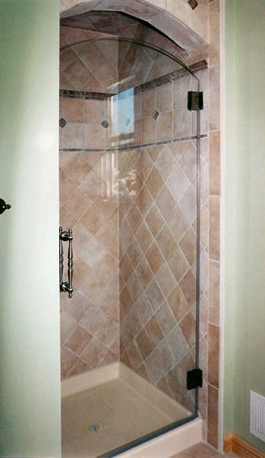 "Frameless shower door with arched top, Starfire glass & a Portals 8"" Sympony handle done in Flemington, NJ"