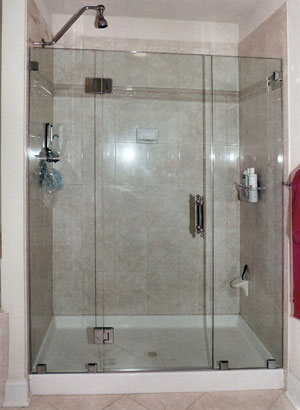 Frameless shower enclosure with glass to glass hinges in Clinton, NJ